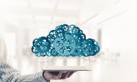 Foto de Close of businessman presenting tablet pc and cloud computing concept. Mixed media - Imagen libre de derechos