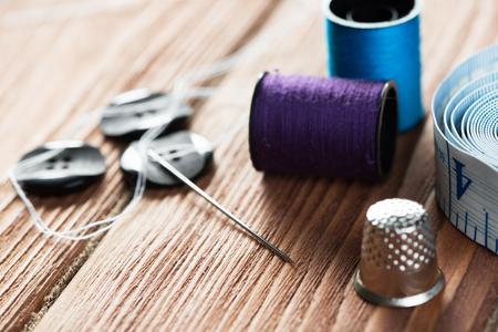 Foto de Bright image of sewing kit accessories on wooden table - Imagen libre de derechos
