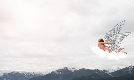 Photo for Young woman flying high in blue sky - Royalty Free Image