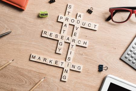 Foto de Words of business marketing collected in crossword with wooden cubes - Imagen libre de derechos