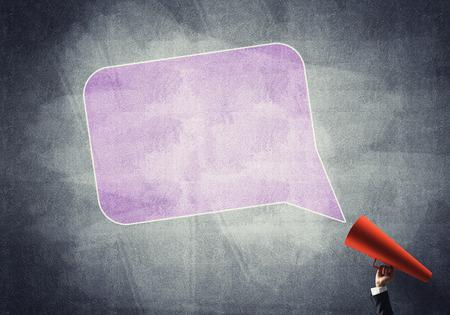 Photo pour Close of businesswoman making announcement in paper trumpet - image libre de droit