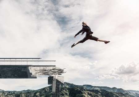 Foto de Business woman jumping over huge gap in concrete bridge as symbol of overcoming challenges. Skyscape and nature view on background. 3D rendering. - Imagen libre de derechos