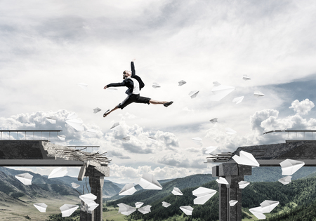 Foto de Business woman jumping over gap in bridge among flying paper planes as symbol of overcoming challenges. Skyscape and nature view on background. 3D rendering. - Imagen libre de derechos