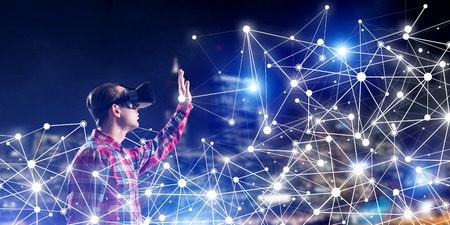 Photo pour Young man with virtual reality headset or 3d glasses among connection lines - image libre de droit