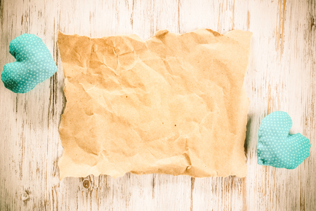 Foto de Brown package paper and love hearts on wooden background - Imagen libre de derechos