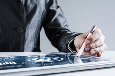Foto für Close of businesswoman sitting at table and touching with stylus tablet pc - Lizenzfreies Bild