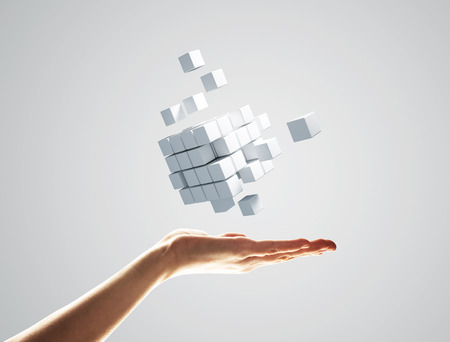 Foto de Close of businessman hand holding cube figure as symbol of innovation. 3D rendering - Imagen libre de derechos