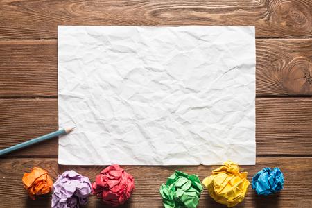 Foto de Close up of sheet of white paper and pencil on wooden table - Imagen libre de derechos