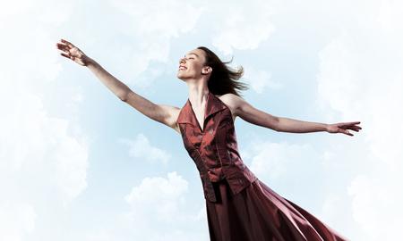 Foto de Young attractive woman relaxing in summer day against sky background - Imagen libre de derechos