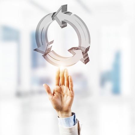Foto de Close of businessman touching in palm reload glass icon. Mixed media - Imagen libre de derechos