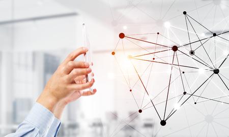 Photo pour Close up businessman hand using smart phone and connection lines as concept. 3d rendering - image libre de droit