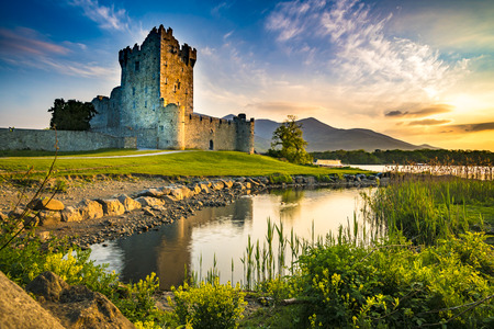 Foto de Ancient old Fortress Ross Castle ruin with lake and grass in Ireland during golden hour nobody - Imagen libre de derechos
