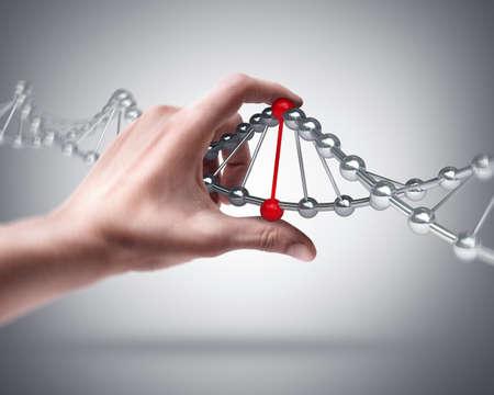 Foto de Man's hand holding capsule with Sample DNA  - Imagen libre de derechos