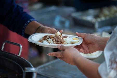 Foto de The society of helping to share food to the poor - Imagen libre de derechos