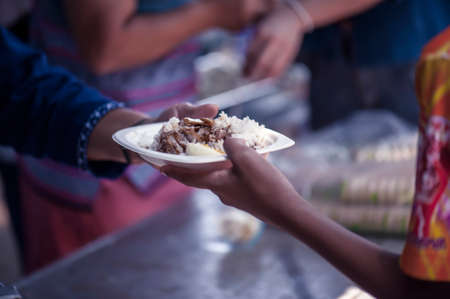 Photo pour Feeding the poor Helping each other in society - image libre de droit
