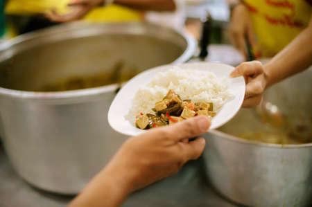 Foto de Charity food is the hope of the poor who have no money: concept of begging food - Imagen libre de derechos