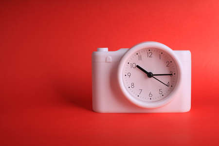 Photo for analog clock on red background - Royalty Free Image