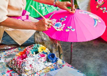 Foto de Umbrella painting, handmade fabric umbrella in Chiang mai (  bo -sang) , Thailand. - Imagen libre de derechos