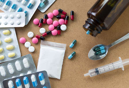 Foto de Drug syringe and heroin spoon medicament  container for health  Pharmacy - Imagen libre de derechos
