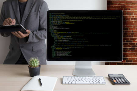Foto de Developer Team Working Laptop Computer Mobile Application Softwareand Web Design Online Technology Content script to display - Imagen libre de derechos