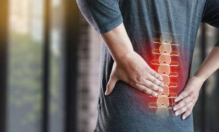 Photo pour young man Feeling suffering  Lower back pain  Pain relief concept - image libre de droit