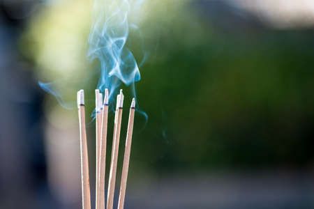 Photo for burning Embossed  sticks and smoke from incense burning and smoke - Royalty Free Image