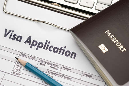 Photo pour Visa application form to travel Immigration a document Money for Passport Map and travel plan - image libre de droit
