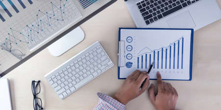 Foto de analyzing the work Accounting on Laptop  investment concept. - Imagen libre de derechos