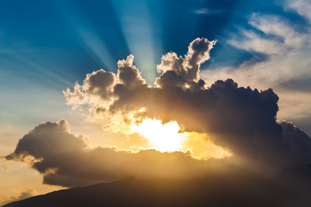 Photo for golden rays of the sun through the black clouds - Royalty Free Image
