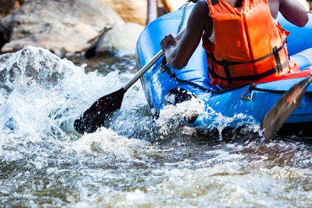 Photo pour Close-up of young person rafting on the river, extreme and fun sport at tourist attraction - image libre de droit