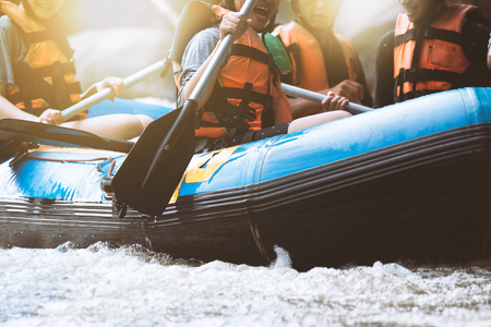 Photo for Young person rafting on the river, extreme and fun sport at tourist attraction - Royalty Free Image