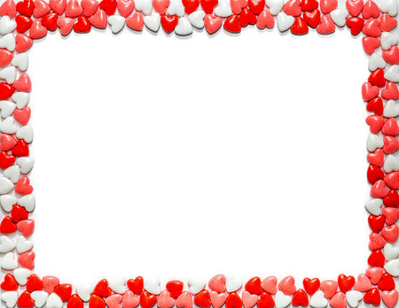 Foto de Heart shaped sweet Valentine's Day candy framing letter size white paper - Imagen libre de derechos