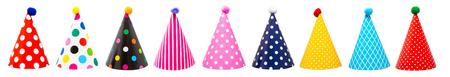 Foto de Row of nine colorful festive birthday party hats with different patterns and pom-poms - Imagen libre de derechos