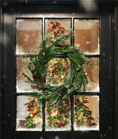 Photo for View looking into home with illuminated Christmas tree through door window with wreath and snow - Royalty Free Image