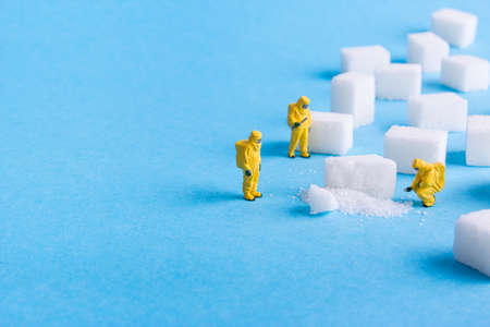 Photo pour The team investigates the sugar cubes on a blue background - image libre de droit
