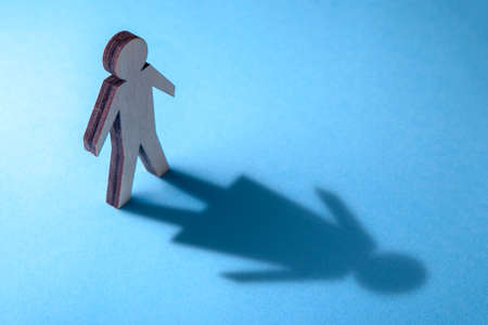 Photo pour The concept of transvestite or bisexual. Tranender, man feels like woman. Shadow of man in the shape of woman. - image libre de droit