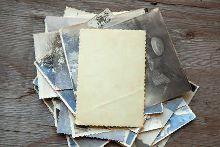 Photo for Stack old photos on table. Mock-up blank paper. Postcard rumpled and dirty vintage. Retro card - Royalty Free Image