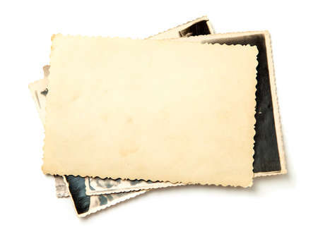 Photo pour Stack old photos isolated on white background. - image libre de droit
