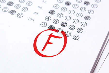 Photo for Bad grade F is written with red pen on the tests. - Royalty Free Image
