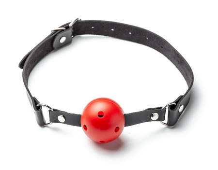 Foto de Red Ball gag in mouth isolated on white background. Intimate toys. Sex abuse slavery. - Imagen libre de derechos