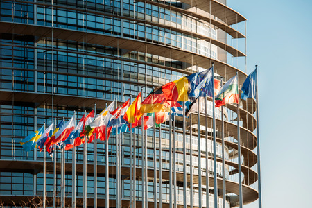 Photo pour The European Parliament building in Strasbourg, France with flags waving on a spring evening - image libre de droit