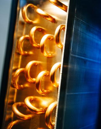 Foto de Condenser unit used in central air conditioning systems - heat exchanger section to cool down and condense incoming refrigerant vapor into liquid - Imagen libre de derechos