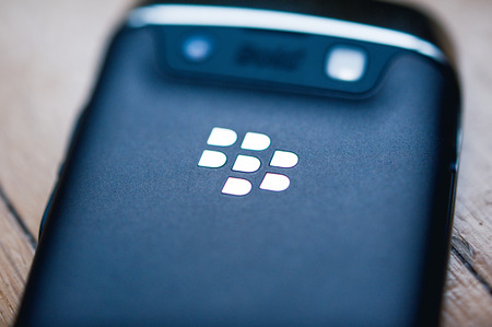 Photo for PARIS, FRANCE - APR 21, 2013: Rear view of a Blackberry phone with the chrome logotype. BlackBerry is a line of wireless handheld device with services designed and marketed by BlackBerry Limited, formerly known as Research In Motion. Tilt-shift lens to fo - Royalty Free Image