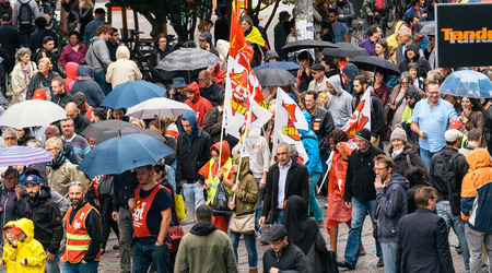 Foto de STRASBOURG, FRANCE - SEPT 12, 2017: View from above of demonstrators walk at political march during a French Nationwide day of protest against the labor reform proposed by Emmanuel Macron Government - Imagen libre de derechos