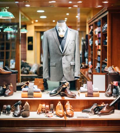 Photo pour Business shirt, belt, suit,blazer, shoes,ties at male tailoring on tailor shop mannequin in male fashion store showcase window - image libre de droit