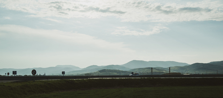 Photo pour French Vosges mountains range with silhouette of car, trucks driving fast on the national autoroute highway with magestic scattered clouds sky - image libre de droit