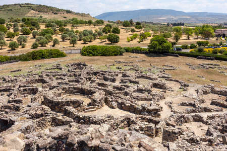 Photo pour Nuragic ruins of the archaeological site of Barumini in Sardinia on the background of the countryside - image libre de droit
