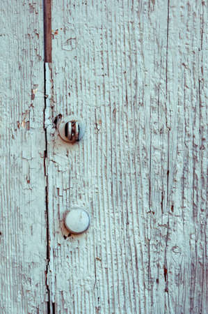 Photo for Wooden panels and planks of rural house door, Italy. Walls and ornaments in painted wood for the country house, ruined by time. - Royalty Free Image
