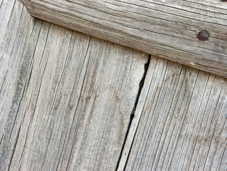 Photo for Panels and wooden boards of a rural house, used for doors, windows and cellars, painted and eroded by time. - Royalty Free Image