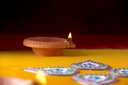 Photo for Rangoli design around Diwali lamp - Royalty Free Image